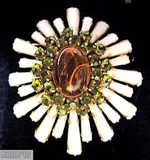 Schreiner oval high domed keystone ruffle pin large oval center varied length keystone white keystone marbled amber large oval cab center peridot 2 round surrounding chaton goldtone jewelry